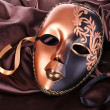 Mask on brown fabric background — Stock Photo #35822269