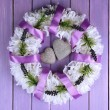 Decorative wreath with hearts on wooden background — Stock Photo