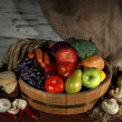 Composition of different fruit and vegetables on table on sackcloth background — Stock Photo #35825267
