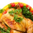 Baked whole chicken with vegetables on a green plate on white background close-up — Stock Photo