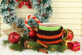 Cup of hot cacao with Christmas decorations on table on wooden background — 图库照片