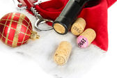 Wine corks with new Year toys isolated on white — Stock Photo