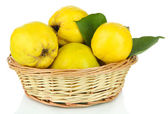 Sweet quinces in wicker basket isolated on white — Stock Photo