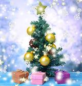 Decorative Christmas tree, on light background — Stock Photo
