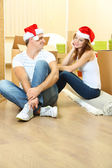Couple in new home celebrating New Years — Stock Photo