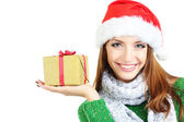 Beautiful smiling girl in New Year hat with gift isolated on white — Stock Photo