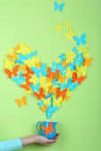 Paper butterflies fly out of pitcher — Stock Photo