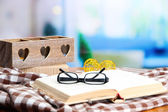 Old book, eye glasses, candles, and plaid — Stock Photo