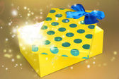 Gift box with bright light on it — Stock Photo