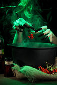 Witch in scary Halloween laboratory — Stock Photo