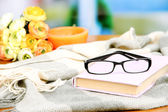 Old book, eye glasses, candles, flowers and plaid — Stock Photo