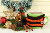 Cup of hot cacao with chocolates and Christmas decorations on table on wooden background — ストック写真