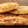 Pita breads on wooden background — Stock Photo