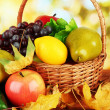 Fruits and vegetables with yellow leaves in basket — Stock Photo #35846549