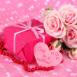 Romantic parcel on pink cloth background — Stock Photo #35849433