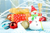 Christmas composition with gift and Christmas toys — Stock Photo