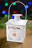 Christmas lantern on table — Stock Photo