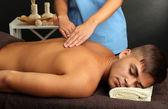 Man having back massage — Stock Photo