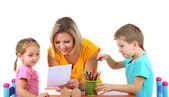 Little children drawing with mom — Stock Photo
