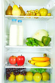 Milk, vegetables and fruits in refrigerator — Stock Photo
