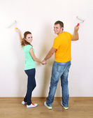 Couple doing renovation in new house — Stock Photo