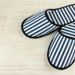 Stock Photo: Striped slippers on wooden background