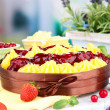 Tasty fruity homemade pie with berries, on table — Stock Photo #35852277