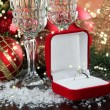 Composition with Christmas decorations and two champagne glasses, on bright background — Stock Photo #35852905