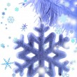 Christmas snowflake on snow-white Christmas tree close-up isolated on white — Stock Photo