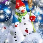 Beautiful snowmen and Christmas decor, on bright background — Stock Photo