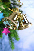 Bells with Christmas decoration on light background — Stockfoto