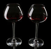 Wineglasses with red wine, isolated on black — Stock Photo