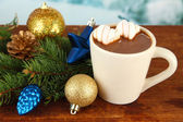 Cup of hot cacao with Christmas decorations on table on bright background — Stock Photo