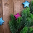 Christmas fir tree  and decorations on wooden background — Stock Photo
