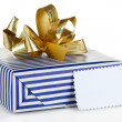 Gift box with blank label isolated on white — Foto de Stock