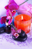 Beautiful spa setting with orchid close-up — Stock Photo