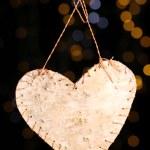 Decorative heart on rope on shiny background — Stock Photo #35946593