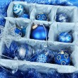 Christmas toys in wooden box on blue background — Stock Photo #35946067