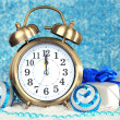 Composition of clock and christmas decorations on bright background — Stock Photo #35946089