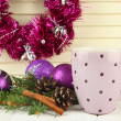 Stock Photo: Cup of hot cacao with bumps and Christmas decorations on table on wooden background
