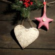 Stock Photo: Decorative heart and star on rope, on wooden background