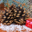 图库照片: Christmas decoration with pine cones on wooden background