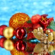 Composition of Christmas balls on blue background — Stock Photo #35947135