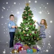 Kids decorating Christmas tree with baubles in room — Stock Photo #35947271