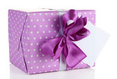Gift box with blank label isolated on white — Stock Photo