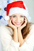Beautiful smiling girl near Christmas tree close-up — Stock Photo