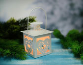 Christmas lantern, fir tree and decorations on dark background — Stock Photo