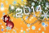 2014 hang on Christmas tree close-up on orange background — Stock Photo
