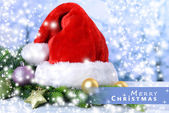 Composition with Santa Claus red hat and Christmas decorations on light background — Photo