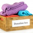 Donation box with clothing isolated on white — Stock Photo #35994191